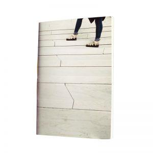 un carnet tout en blanc pour aller de l'avant
